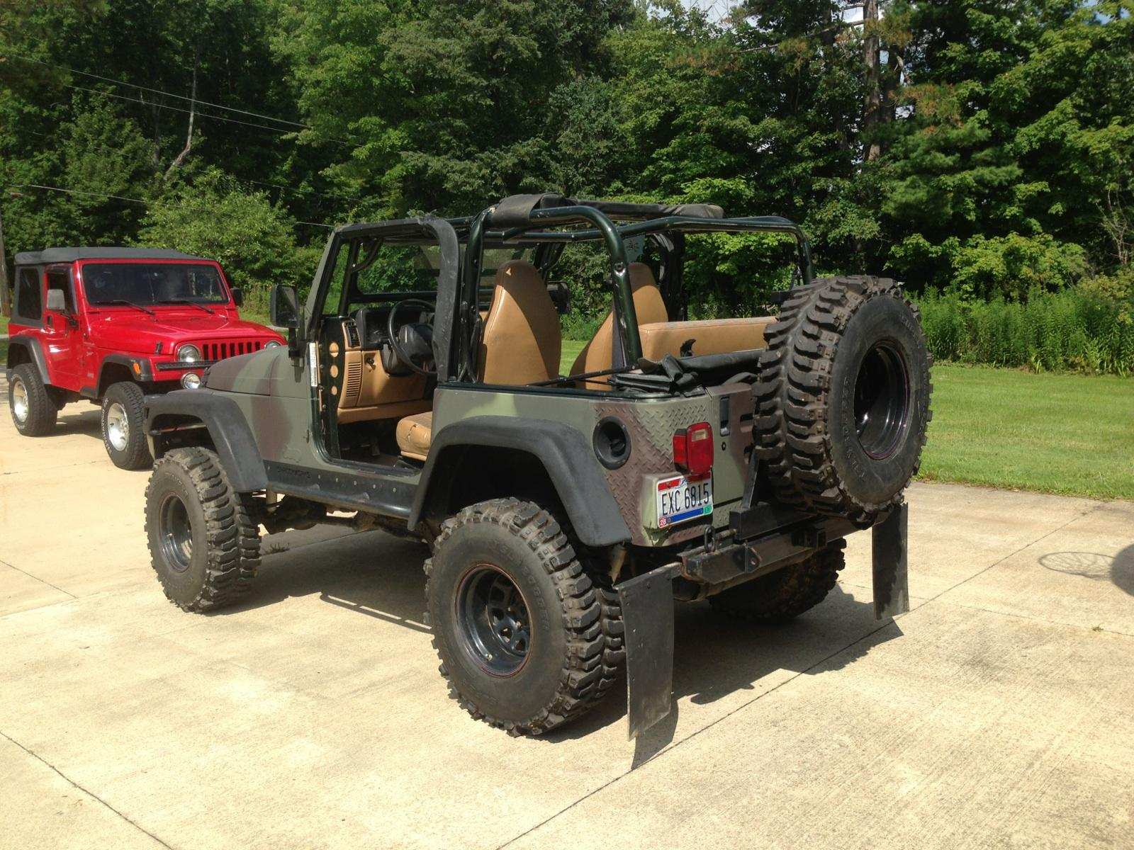 Jacked Up Jeep Wrangler >> Jacked Up 1997 Camo Jeep 5 Speed Low Miles 10 000 United Car