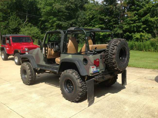 jacked up 1997 camo jeep – 5 speed, low miles – $10,000 ...
